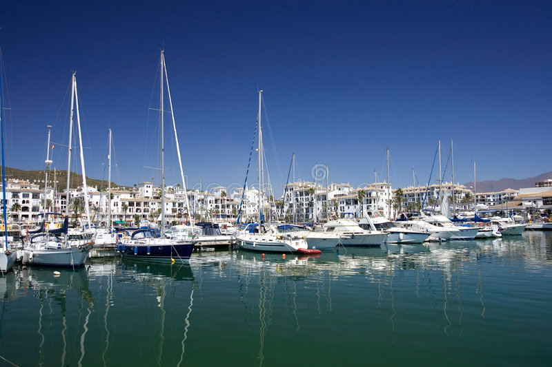 Tall luxury boats and yachts moored in Duquesa port in Spain on royalty free stock image