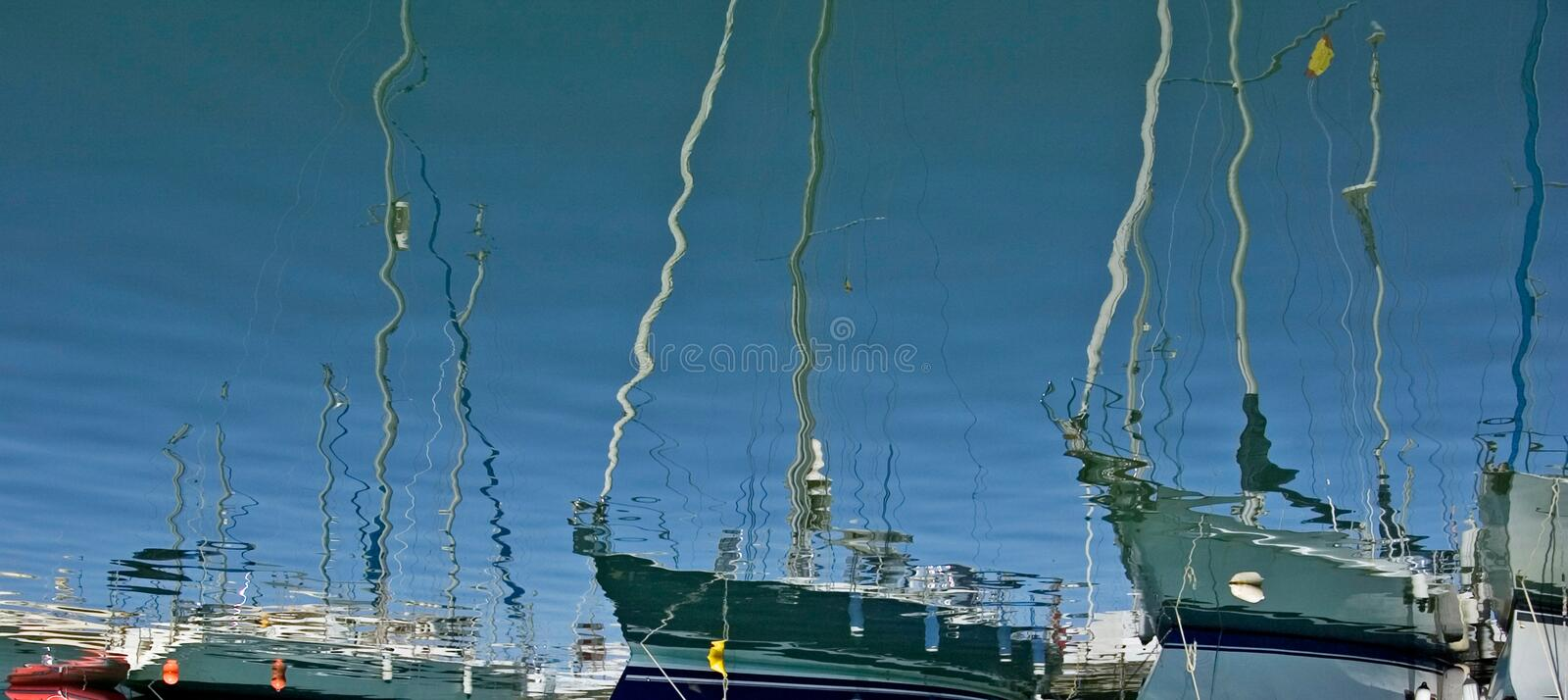 Tall luxury boats and yachts moored in Duquesa port in Spain on royalty free stock images