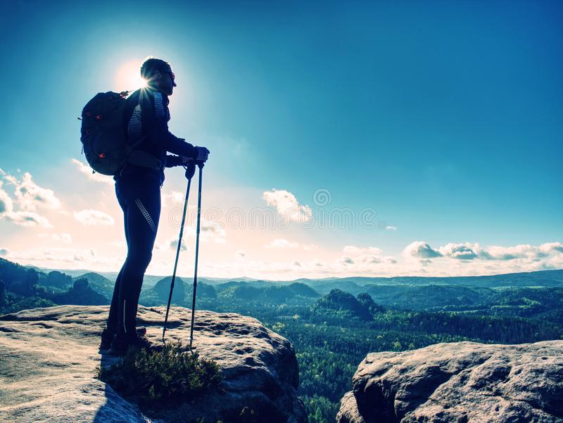 Tall man taking an excursion on a mountain. Mountain hiker royalty free stock image