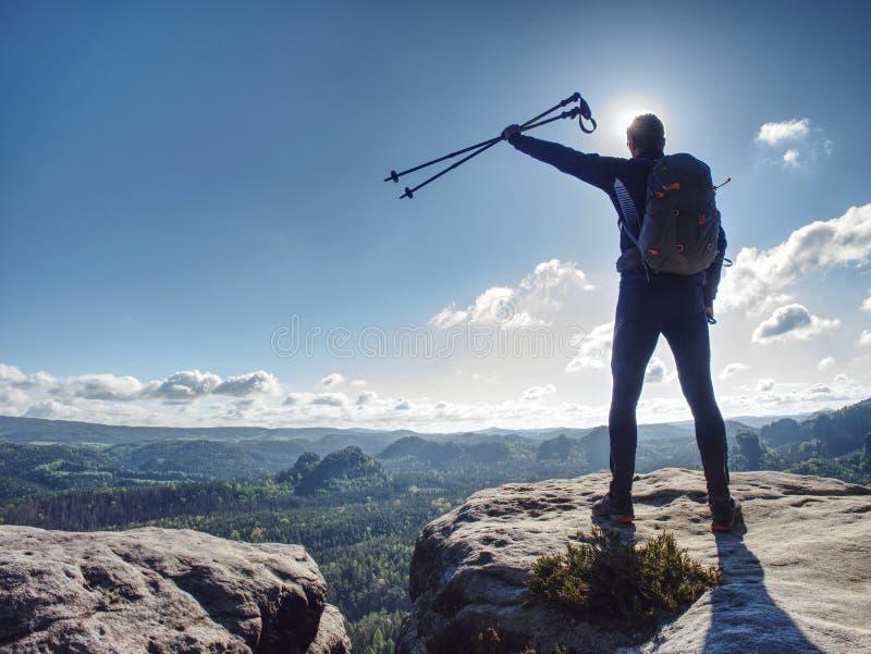 Tall man taking an excursion on a mountain. Mountain hiker stock image
