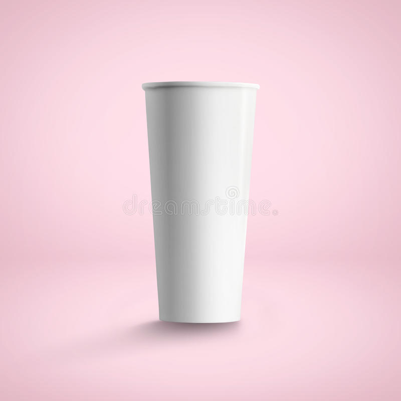 Tall paper coffee cup, over soft pink background. Use stock image