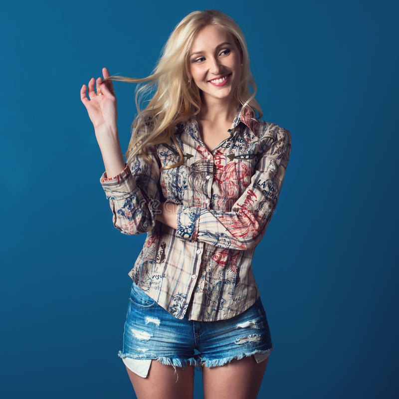 Tall pretty blond girl with adorable smile stock photography