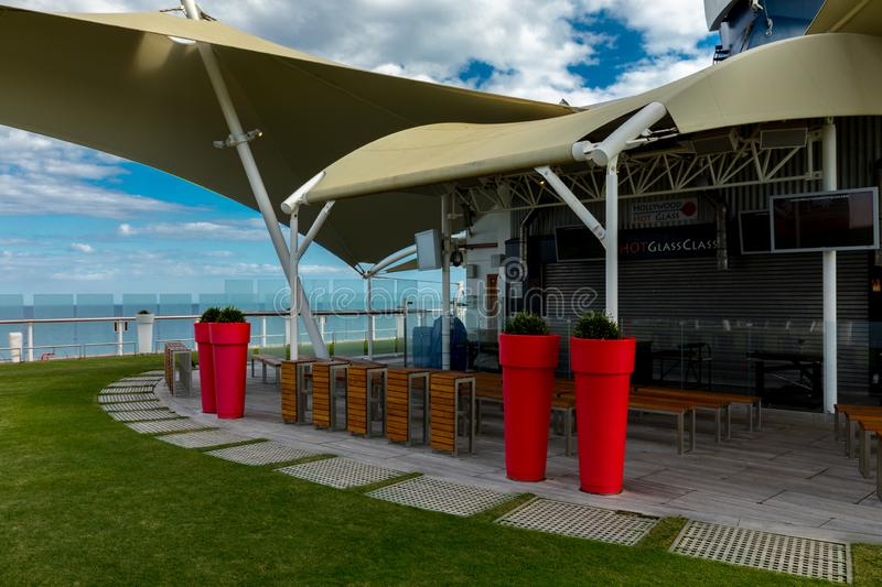 Tall Red Pots and Real Grass Aboard Celebrity Eclipse Cruise royalty free stock images