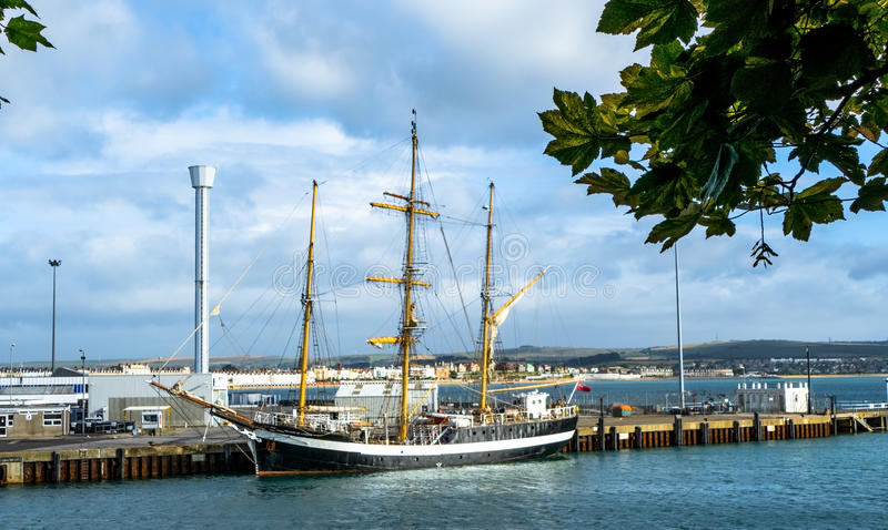 Tall Ship Moored at the Harbour Entrance stock photo