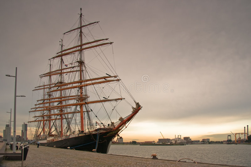 Tall ship in port. Big Tallship in port at sunset royalty free stock photo