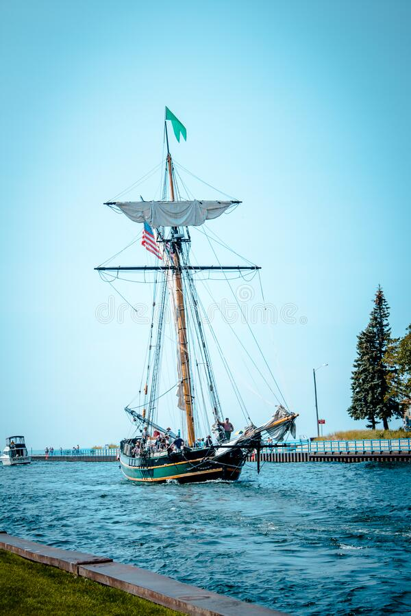 Tall ship setting sail from a harbor. In Michigan royalty free stock photo