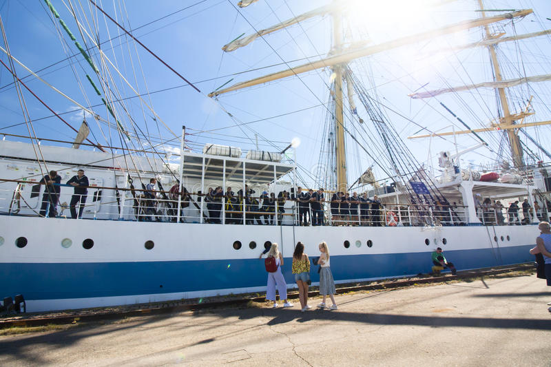 THE TALL SHIPS RACES KOTKA 2017. Kotka, Finland 16.07.2017. Ship Mir in the port of Kotka, Finland. Girls escort sailors. stock photos