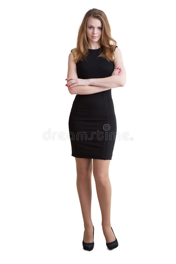 The tall slender young woman in short black dress. The tall slender young woman blonde in a short black dress and shoes high-heeled royalty free stock photography
