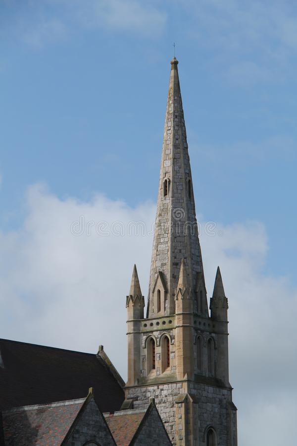 Tall Church Spire. The Tall Spire of an Old Stone Built Christian Church stock images