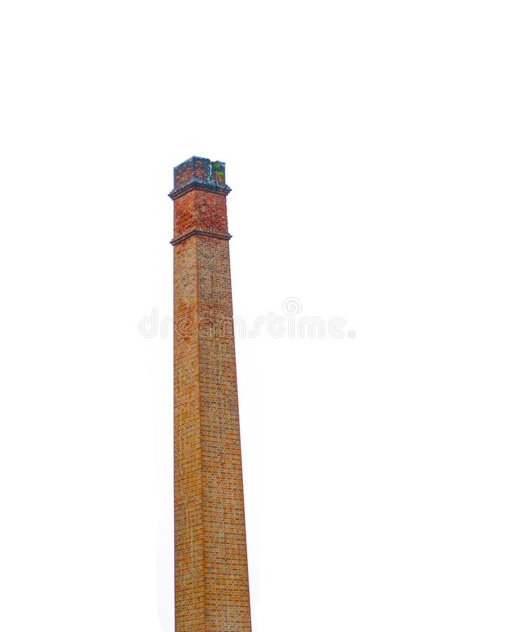 Tall square Red brick chimney isolated on white background. royalty free stock images