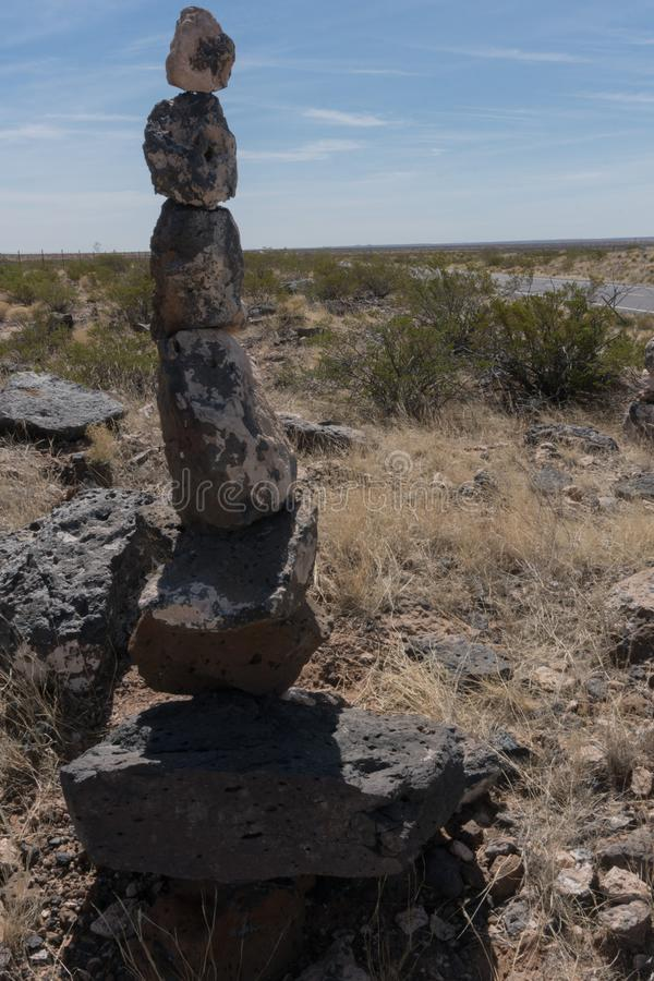 Tall stone cairn along state highway nine in New Mexico. stock photos