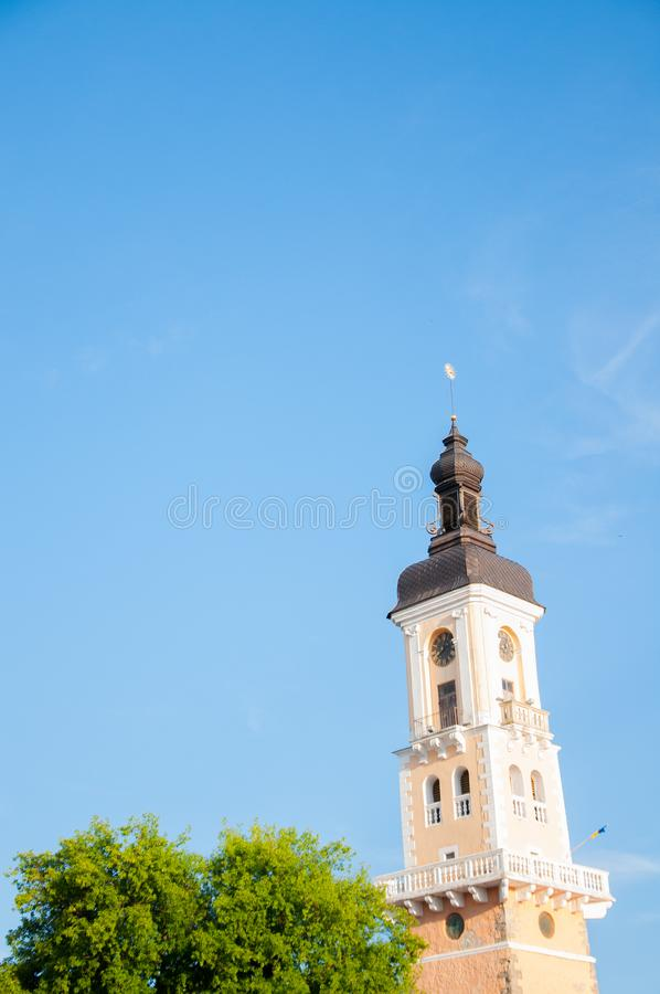 A tall tower with a spire and a dome. Temple royalty free stock image