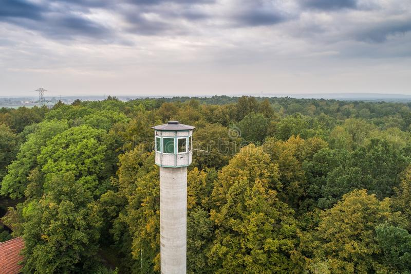 Tall watch tower in the forest. stock image