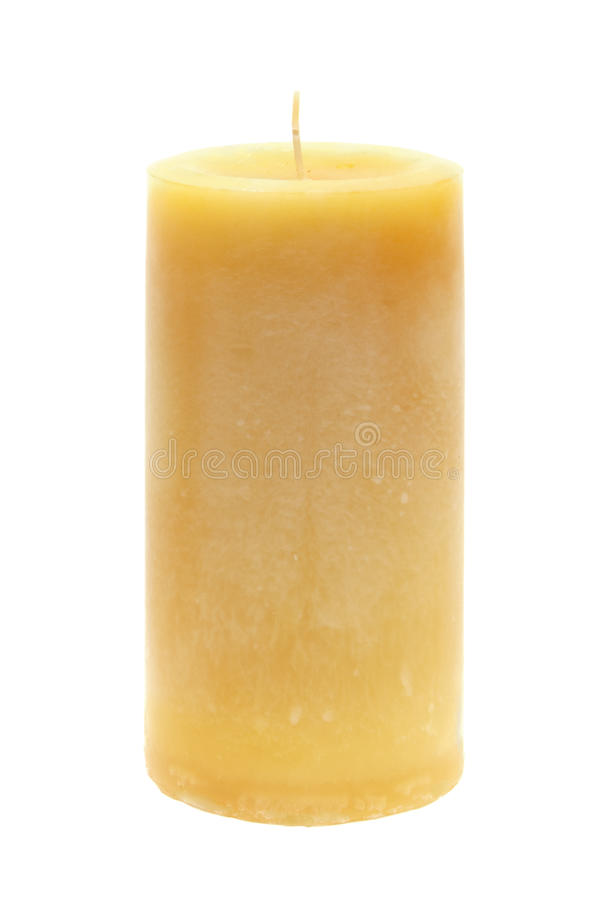 Tall yellow wax candle on white royalty free stock photo