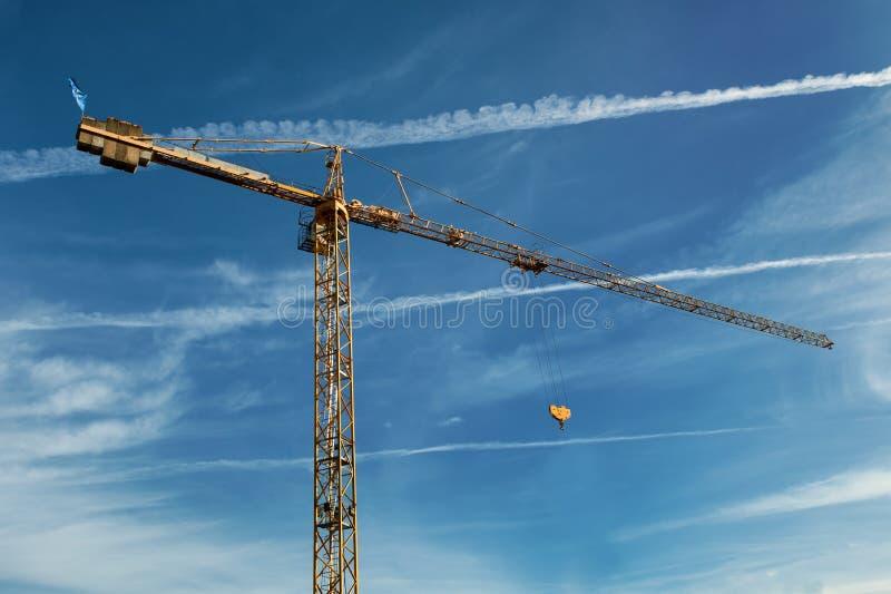 Tall yellow working crane stock photos