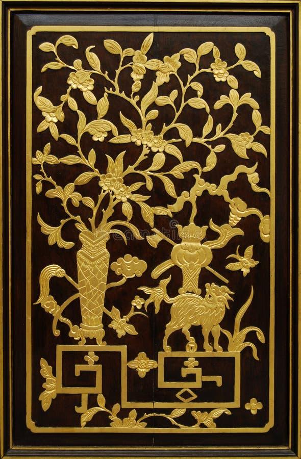 Talla china de madera imagen de archivo