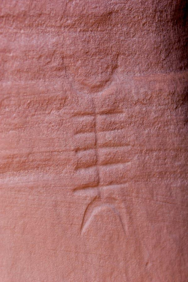 Tallas y arte antiguo en las paredes de barranca fotografía de archivo libre de regalías