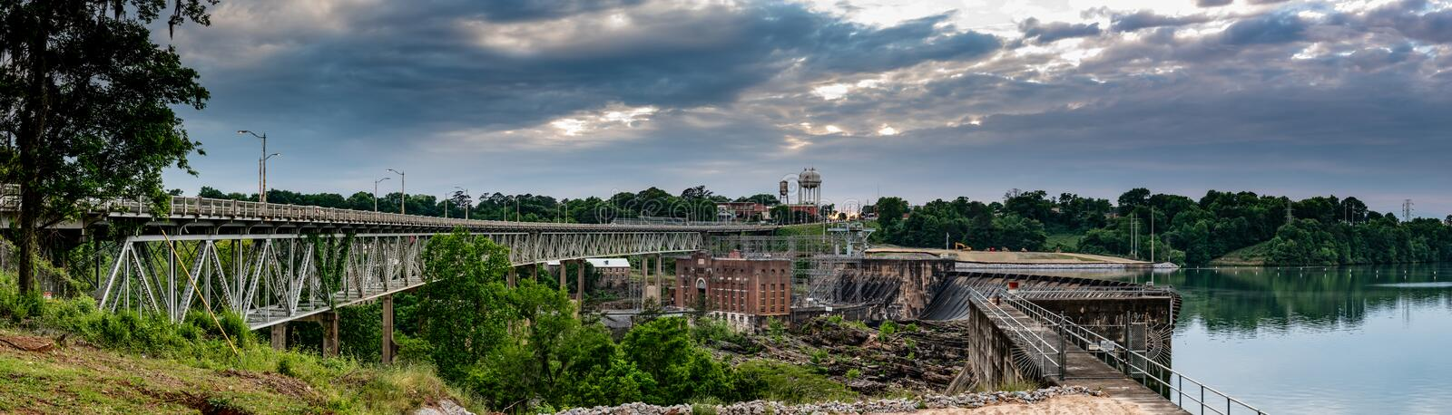 Tallassee, Alabama Panorama image. Tallassee, Alabama, USA - May 5, 2018: Panorama of the historical Thurlow Dam and the hydroelectric plant on the Tallapoosa royalty free stock photo