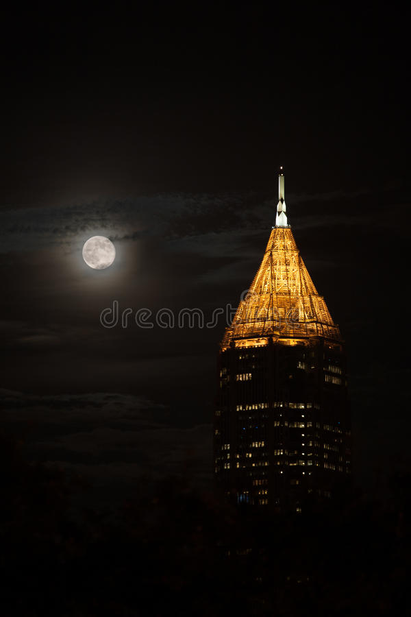 Tallest building in Atlanta downtown in the night with full moon stock image