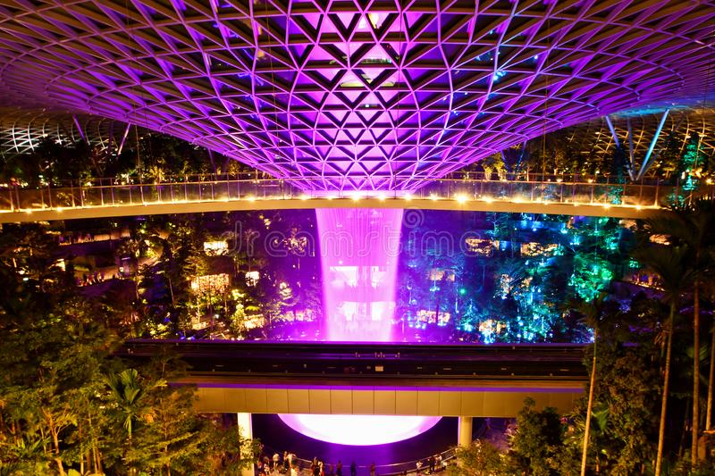 Nightshot of Jewel Changi Airport HSBC Rain Vortex. The tallest indoor waterfall as of 2019, the HSBC Rain Vortex is the star attraction of Jewel Changi Airport royalty free stock image