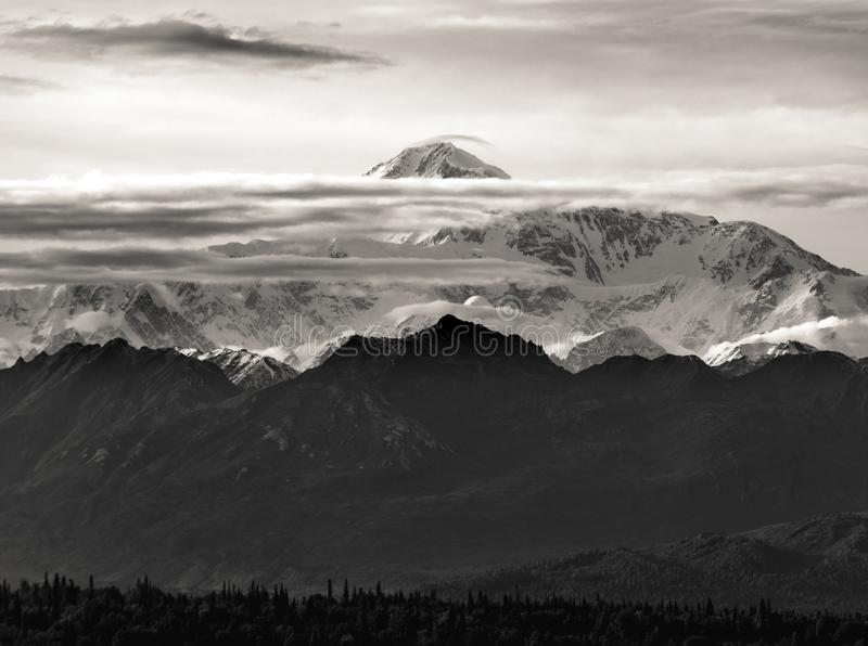The tallest mountain in North America, Denali, in a rare view between the clouds stock photo