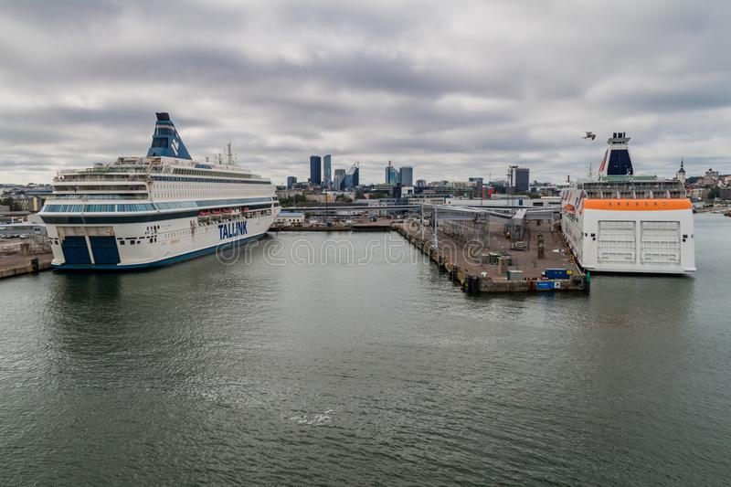 TALLINN, ESTONIA - AUGUST 24, 2016: MS Silja Europa and MS Baltic Queen cruiseferries owned by the Estonia-based ferry. Operator Tallink in a harbor in Tallinn royalty free stock image