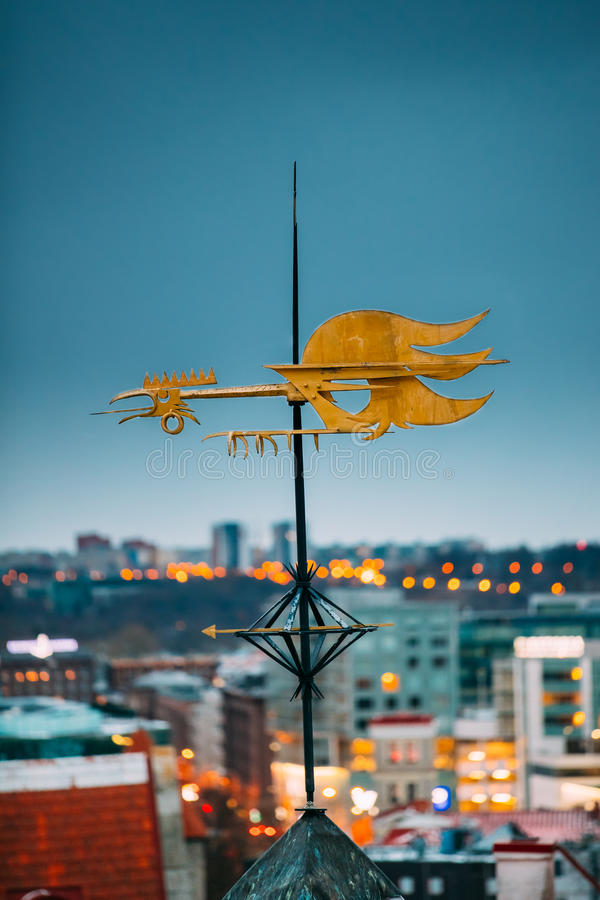 Tallinn, Estonia, Europe. Cock-rope Weather Vane On Roof Of Old Medieval House In Winter Evening In Night stock photo