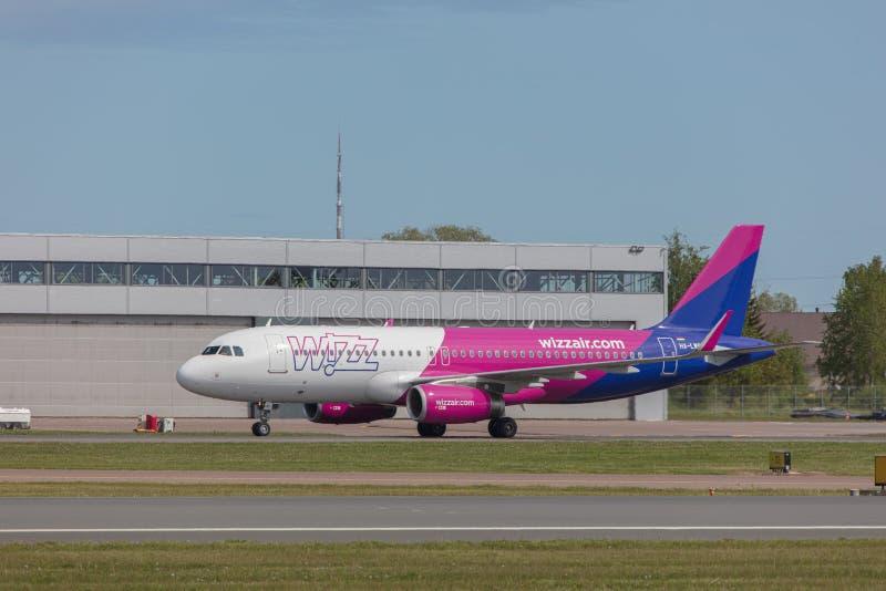 Tallinn, Estonia - June 03, 2019: Airbus A320-232 aircraft HA-LWS Wizz Air. Lands at Tallinn Airport royalty free stock photography