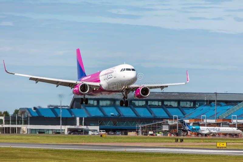 Tallinn, Estonia - June 03, 2019: Airbus A320-232 aircraft HA-LWS Wizz Air. Lands at Tallinn Airport royalty free stock photo