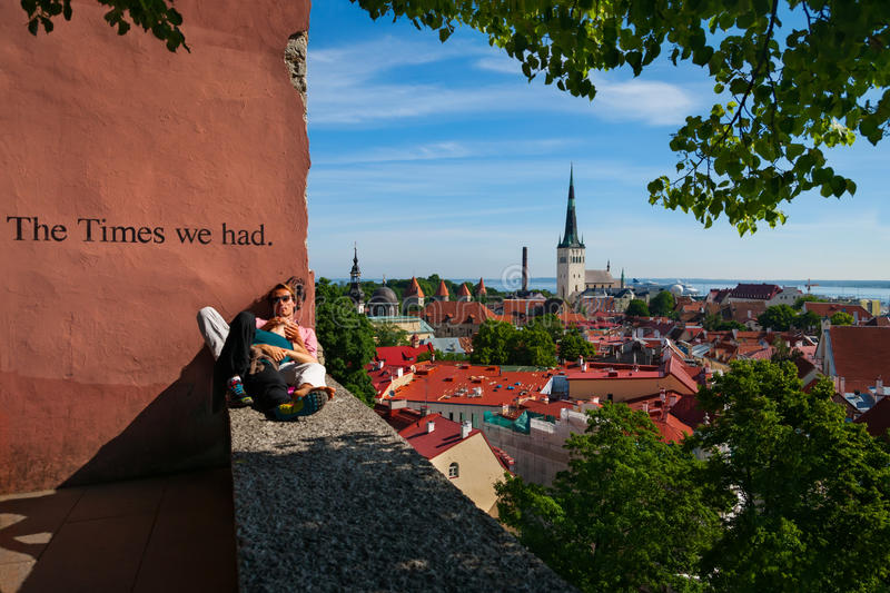 Tallinn, Estonia-June 14, 2016 - Young embracing couple sit on observation deck. royalty free stock photo