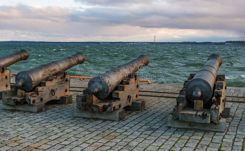 Tallinn, Estonia - November 18, 2018: Old cannons in the Maritime Museum of Tallinn. Cannon on wooden gun carriages. Cannons fired cannonballs. Guns are on the royalty free stock photo