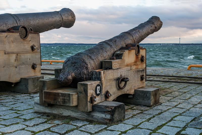 Tallinn, Estonia - November 18, 2018: Old cannons in the Maritime Museum of Tallinn. Cannon on wooden gun carriages. Cannons fired cannonballs. Guns are on the stock photography