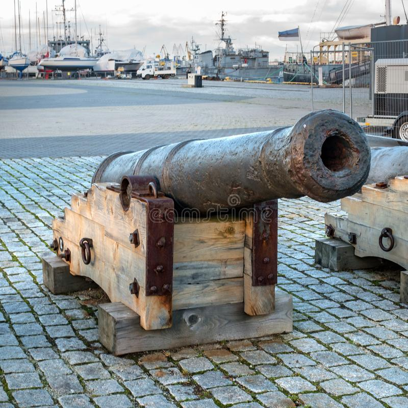 Tallinn, Estonia - November 18, 2018: Old cannons in the Maritime Museum of Tallinn. Cannon on wooden gun carriages. Cannons fired cannonballs. Guns are on the stock photo