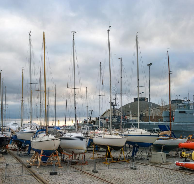 Tallinn, Estonia - November 18, 2018: Parking of small yachts in the Flight Harbor -Lennusadam-. Yachts are prepared for. The winter season. In the background royalty free stock photos