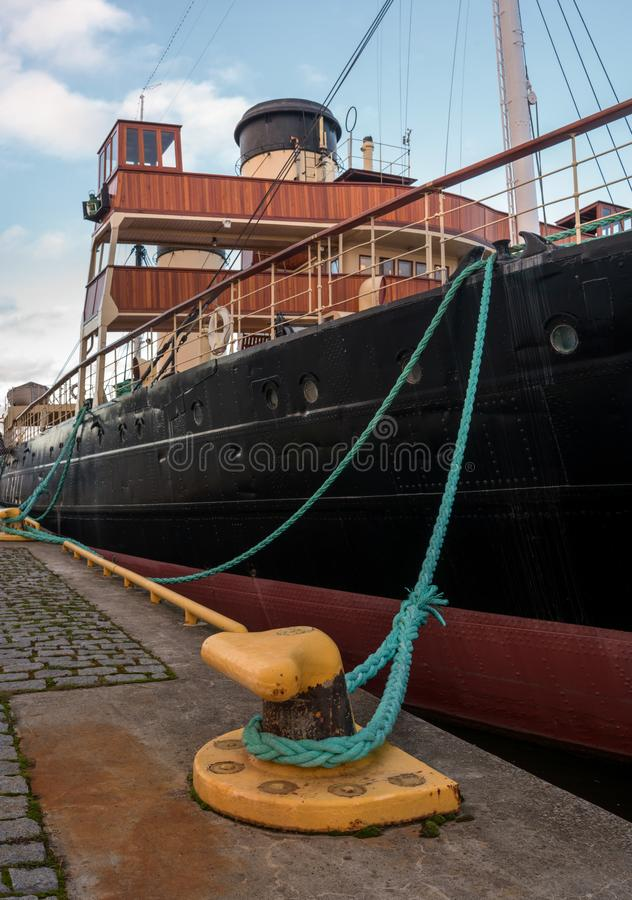 Tallinn, Estonia - November 18, 2018: Suur Toll icebreaker at the pier. The icebreaker steamer is part of the Tallinn. Maritime Museum. There is a mooring royalty free stock image