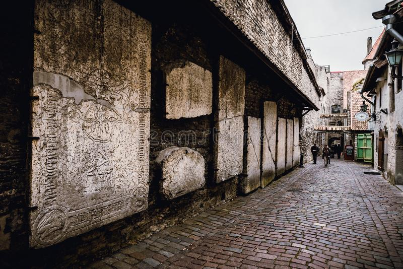 TALLINN, ESTONIA - November 02, 2019: The view of wall in the medieval street of St. Catherine`s Passage in Tallinn city center stock photography