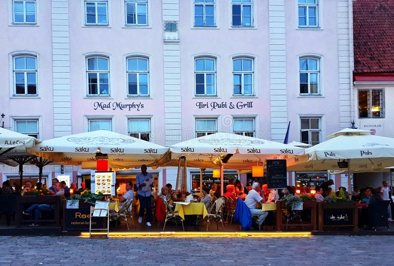 Tallinn ,Estonia 0,08,2019 Old Town Of Tallinn Viru Street cafe city life evening summer people walk relax and  sit in chair  cafe royalty free stock photography
