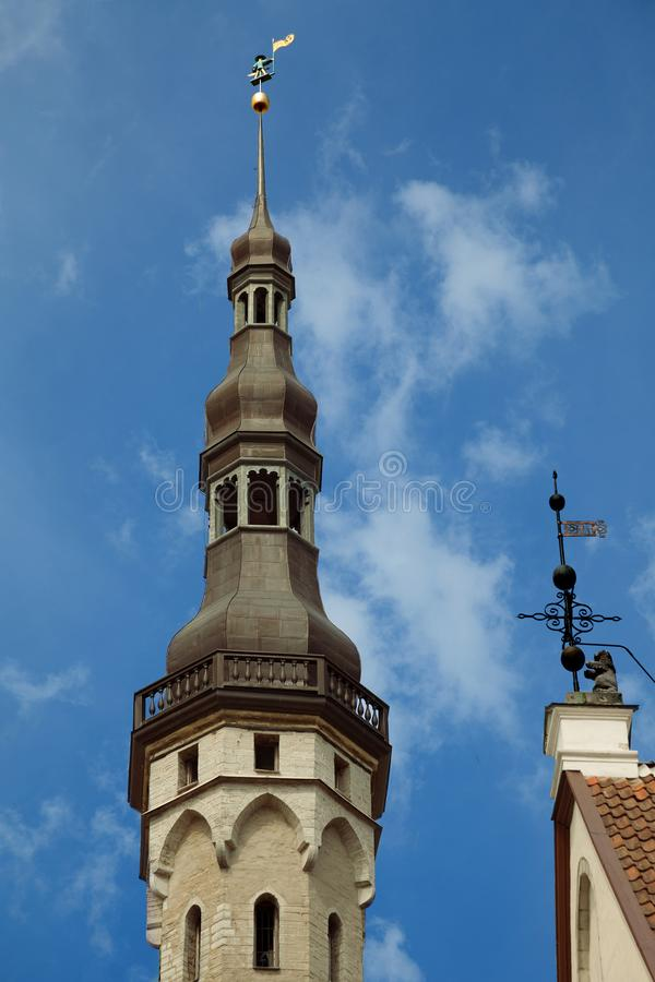 TALLINN, ESTONIA - The Town Hall building with weather vane Old Thomas. Old Thomas Vana Toomas is one of the symbols and guardia stock images