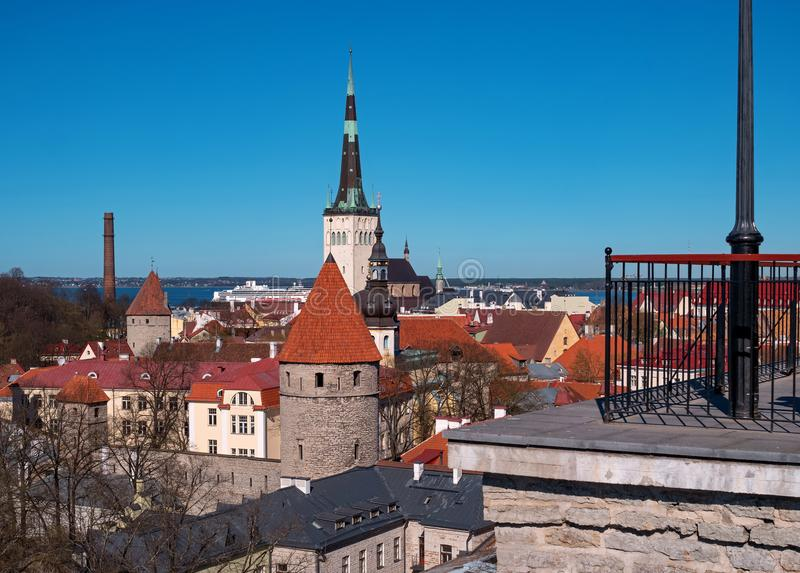 Tallinn Old Town on Toompea Hill, Estonia, panoramic view with traditional red tile roofs, medieval churches and walls. On the right is a fragment of the stock photography