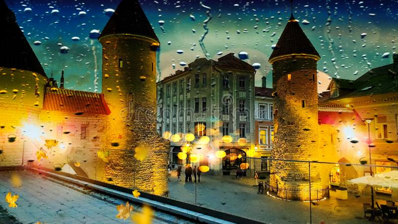 Tallinn Rainy Autumn evening  rain drops City Light blurred  Old tower Lifestyle Street  city light Old Town Tallinn town square. Reflection abstract ,  night royalty free stock photography
