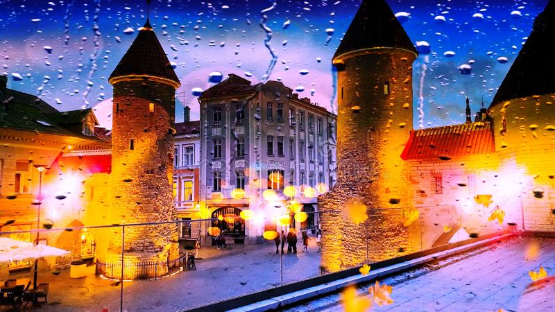 Tallinn Rainy Autumn evening  rain drops City Light blurred  Old tower Lifestyle Street  city light Old Town Tallinn town square. Reflection abstract ,  night stock images