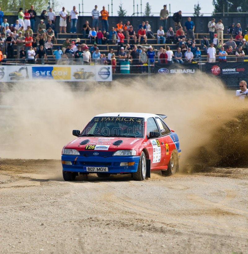 Tallinn Rally 2008. Ford Escort rally car accelerating hard out of the corner on a gravel track. Dual gravel racetrack in Estonia, Laitse Rally Park stock photos