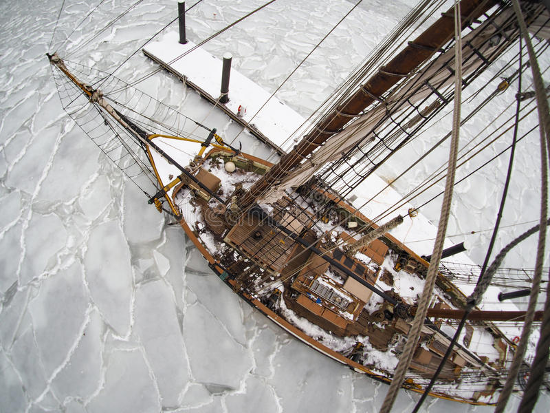 Tallship or sailboat frozen in ice royalty free stock photos
