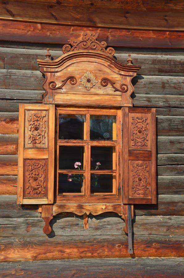 Taltsy, Irkutsk region, Russia, March, 02, 2017. Irkutsk architectural-ethnographic Museum `Taltsy`. Village hut, a window with ca royalty free stock photography
