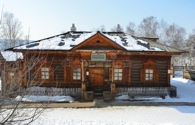 Taltsy, Irkutsk region, Russia, March, 02, 2017. Wooden building of `Township Board` in the Irkutsk architectural-ethnographic Mus stock photography