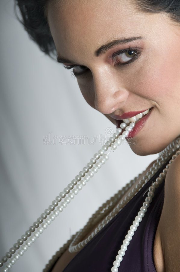 Talya pearls with wind smiling stock photography