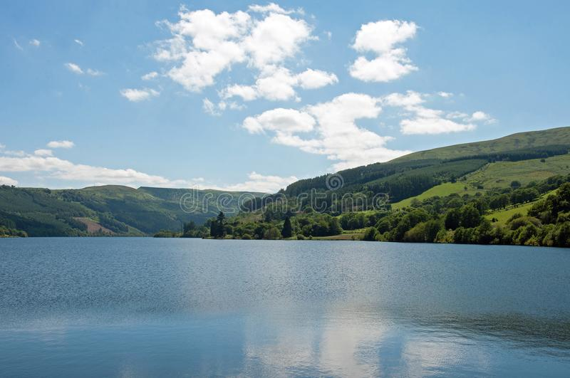 Talybont lake in the summertime. A summertime scene of Talybont reservoir in the mountains of Wales and the Brecon beacons, United Kingdom stock photos