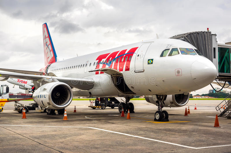 TAM Airlines Airplane at Guarulhos Airport in Sao Paulo, Brazil. TAM Airlines Airbus 320 parked at Guarulhos airport in Sao Paulo, Brazil. TAM is the Brazilian royalty free stock photography