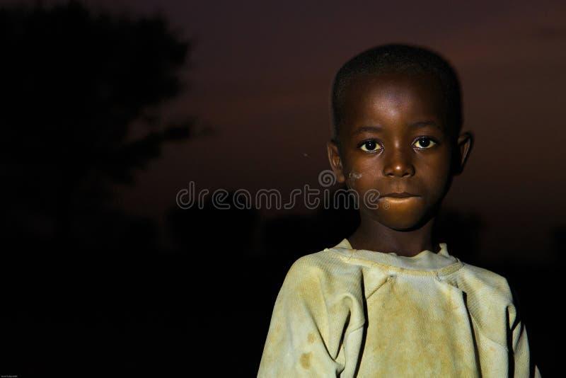 TAMALE, στις 23 Μαρτίου ¿ ½ της ΓΚΑΝΑΣ ï: Μη αναγνωρισμένο αφρικανικό αγόρι με το σκοτεινό ε στοκ φωτογραφίες με δικαίωμα ελεύθερης χρήσης