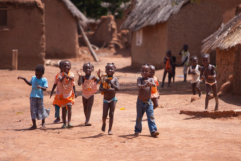 TAMALE, GHANA � MARCH 24: Unidentified young African kids greeti stock photo